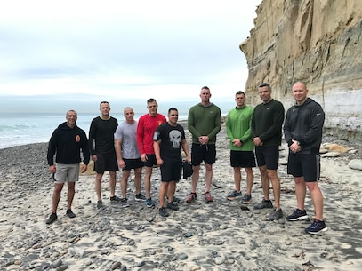 """The Recruiting Station Commanders of ""Force 12"" run the beach trails of Torrey Pines, California, as part of the District Commander's Operations & Training Symposium held 13 Feb 2019."""