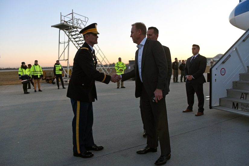 Acting Defense Secretary Patrick M. Shanahan exchanges greetings with a military leader.