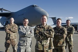 U.S. Air Force Lt. Col. Gary Charland Jr., center, 60th Aircraft Maintenance commander, poses for a photo with senior non-commissioned officers from the 60th AMXS Feb. 6, 2019, in front of a C-5M Super Galaxy at Travis Air Force Base, Calif. Charland was awarded the Lieutenant General Leo Marquez field grade manager category award for aircraft maintenance. (U.S. Air Force photo by Airman 1st Class Jonathon Carnell)