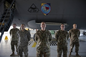 U.S. Air Force Lt. Col. Gary Charland Jr., center, 60th Aircraft Maintenance commander, poses for a photo with senior non-commissioned officers from the 60th AMXS Feb. 6, 2019, next to a C-5M Super Galaxy at Travis Air Force Base, Calif. Charland was awarded the Lieutenant General Leo Marquez field grade manager category award for aircraft maintenance. (U.S. Air Force photo by Airman 1st Class Jonathon Carnell)