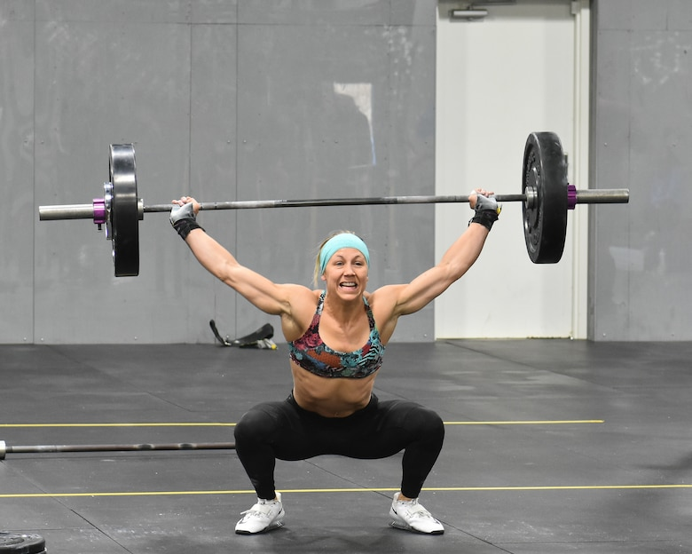 Capt. Rachel Schreiber doing on overhead squat during the U.S. Army Warrior Fitness Team Tryouts