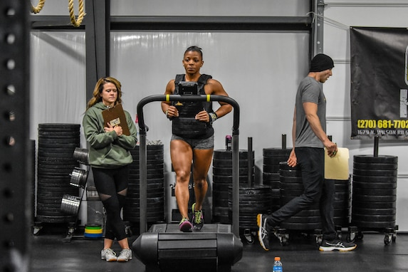 "Capt. Kasandra ""Kaci"" Clark completing the half Murch on the Assault AirRunner during the U.S. Army Warrior Fitness Team Tryouts"