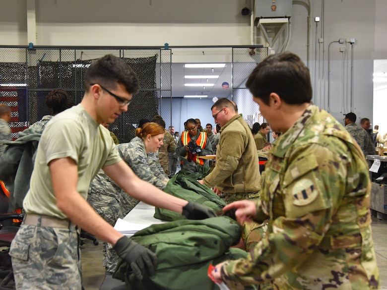 913th Airlift Group Airmen are issued personal protective equipment while processing through the pre-deployment function line Jan. 3, 2019, at Little Rock Air Force Base, Ark.