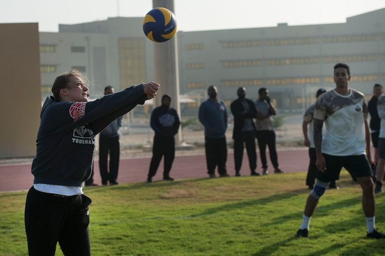 U.S. Air Force Capt. Erica Olson, 379th Air Expeditionary Wing, passes a volleyball to her teammates during a volleyball game as part of Qatari National Sports Day Feb. 12, 2019, at Al Udeid Air Base, Qatar. U.S. and Qatar military forces were able to compete in team events including basketball, volleyball and soccer, as well as individual events such as swimming and ping pong throughout the morning. Qatari National Sports Day provided servicemembers from both nations an opportunity to strengthen military relations through friendly competition. (U.S. Air Force photo by Tech. Sgt. Christopher Hubenthal)