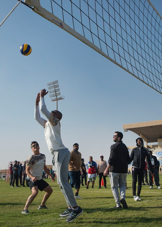 U.S. Air Force Brig. Gen Jason Armagost, 379th Air Expeditionary Wing (AEW) commander (left), and Chief Master Sgt. Jerry Williams, 379th AEW command chief (center left), compete in a volleyball game alongside leaders of the Qatar Emiri Air Force as part of Qatari National Sports Day Feb. 12, 2019, at Al Udeid Air Base, Qatar. U.S. and Qatar military forces were able to compete in team events including basketball, volleyball and soccer, as well as individual events such as swimming and ping pong throughout the morning. Qatari National Sports Day provided servicemembers from both nations an opportunity to strengthen military relations through friendly competition. (U.S. Air Force photo by Tech. Sgt. Christopher Hubenthal)