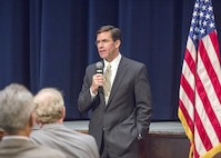 """Secretary of the Army Mark T. Esper says the service must modernize or """"risk losing the first fight of the next war."""" He spoke on a panel with his counterparts from the Navy and Air Force at the Center for Strategic and International Studies in Washington, D.C., Feb. 8, 2019. Pictured here, Secretary Esper addresses members of the Picatinny Arsenal workforce during a visit on Aug. 26, 2018. (Photo Credit: Edward Lopez)"""