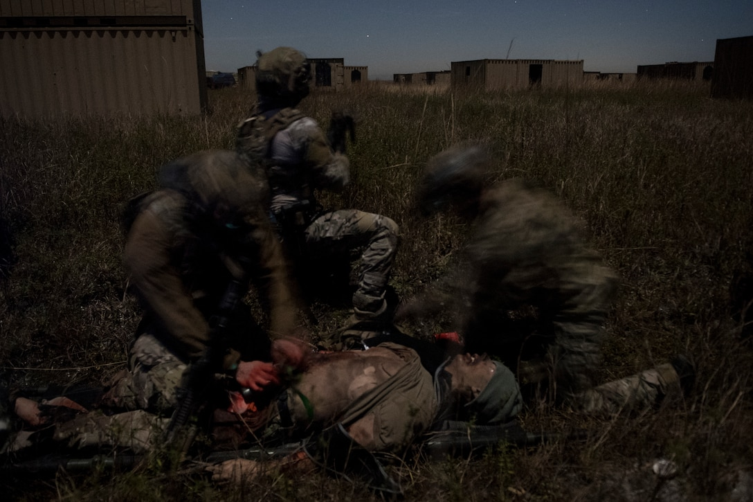 Airmen treat a simulated improvised explosive device blast patient during training