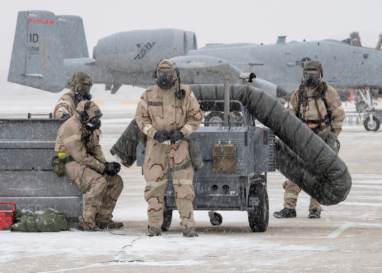 Crew chiefs wait for an A-10 Thunderbolt in the snow