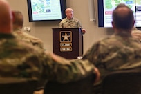 Col. Scott Gilman, the U.S. Army Central Training and Exercises division chief, briefs senior leaders from USARCENT, the U.S. Army Reserves and the U.S. Army National Guard during the Operation Spartan Shield Community of Excellence Forum at Patton Hall on Shaw Air Force Base, S.C., Feb. 6, 2019.