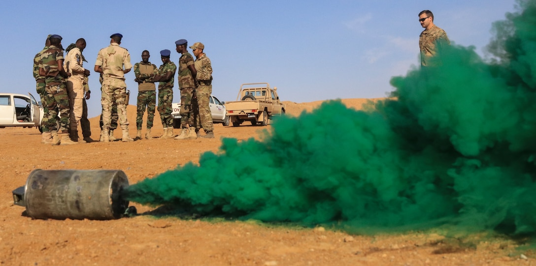 Tactical concealment is used with green smoke.