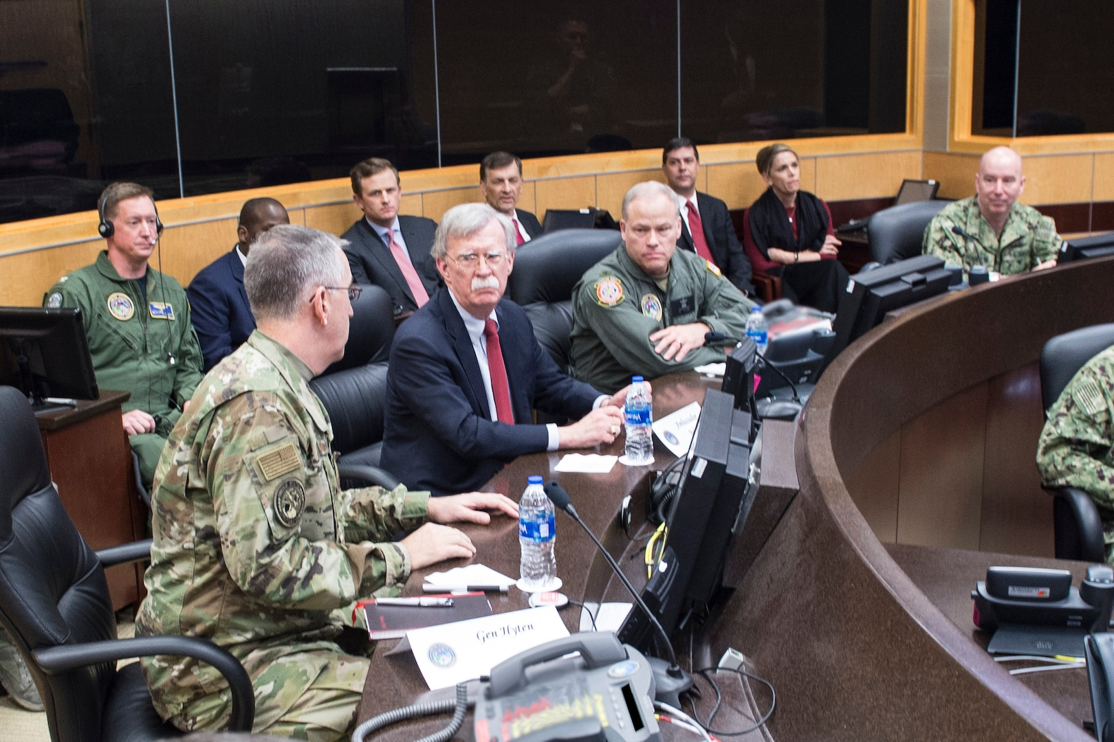 Ambassador John Bolton, National Security Advisor, receives a command and control update from Air Force Gen. John Hyten, commander of United States Strategic Command (USSTRATCOM), on the command's Battle Deck during his trip to USSTRATCOM, Offutt Air Force Base, Neb., Feb. 14, 2019. The Ambassador observed USSTRATCOM's combat-ready force, engaged in discussions with senior leaders and thanked warfighters for their service to the nation. Bolton's visit also highlighted USSTRATCOM's critical role in the National Security Strategy. (U.S. Navy photo by Mass Communications Specialist Julie Matyascik)