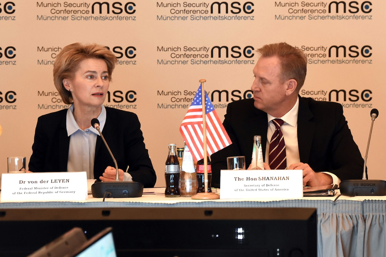 Two defense leaders speak during a security conference,