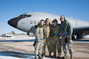 The Aircraft Maintenance Crew of a KC-135R Stratotanker, tail number 58-0104 from the 157th Air Refueling Wing, New Hampshire Air National Guard, pose for a group photo prior to flying the aircraft to the 126th ARW, Scott  Air Force Base, Illinois, Jan. 30, 2019. From left, Staff Sgt. Jared Karos, Master Sgt. John Bober, Staff Sgt. Joe Depalma, Tech. Sgt. William Waters. The aircraft is one of eight aircraft leaving the Wing during the unit's divestiture of the KC-135. (U.S. Air National Guard photo by Tech. Sgt. Aaron P. Vezeau)