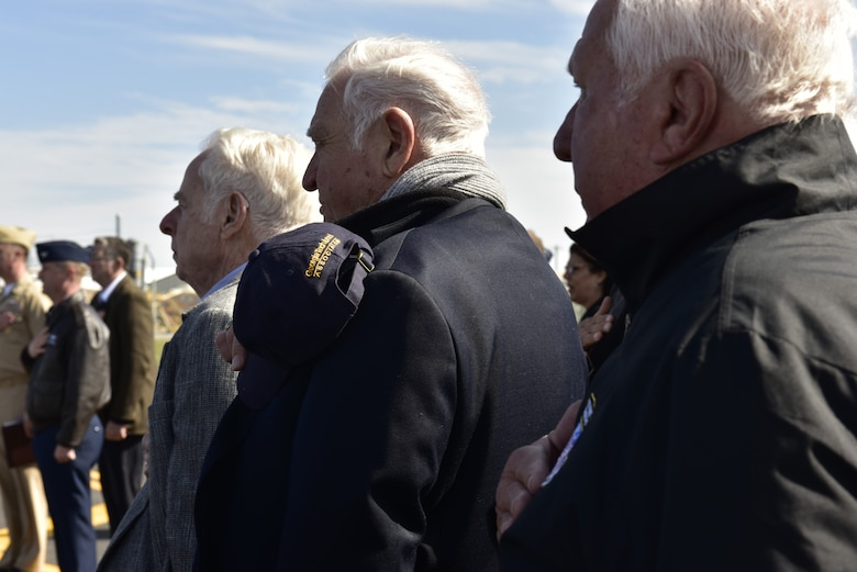Members of the Great American Defense Community render honors during the playing of the national anthem at the beginning of an award ceremony with the Great American Defense Community at Tyndall Air Force Base, Fla., Feb. 13, 2019. Tyndall was awarded the Great American Defense Community Award for 2019 with a commemorative logo painted on the water tower to represent Bay County's accomplishments. Bay County is one of five communities across the country to be named a Great American Defense Community in 2019.  (U.S. Air Force photo by Staff Sgt. Alexandre Montes)