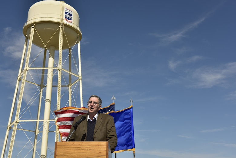 Tom Neubauer, Bay Defense Alliance president, talks about the relationship between the American Defense Community and the military community during an unveiling at Tyndall Air Force Base, Fla., Feb. 13, 2019. Tyndall was awarded the Great American Defense Community Award for 2019 with a commemorative logo painted on the water tower to represent Bay County's accomplishments. Bay County is one of five communities across the country to be named a Great American Defense Community in 2019. (U.S. Air Force photo by Staff Sgt. Alexandre Montes)