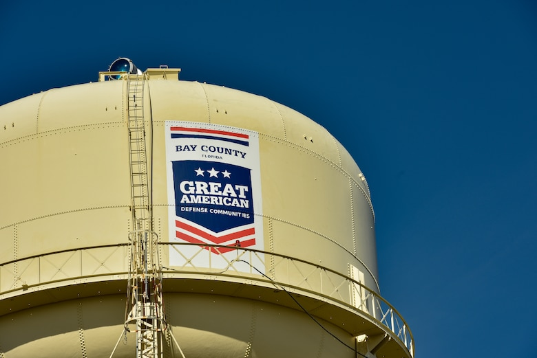 Tyndall Air Force Base's water tower now wears a logo that signifies being awarded the 2019 Great American Defense Community Award during a ceremony at Tyndall Air Force Base, Fla., Feb. 13, 2019. The GADC program leaders work to recognize military communities and regions that help improve the quality of life for veterans, service members and their families. (U.S. Air Force photo by Staff Sgt. Alexandre Montes)