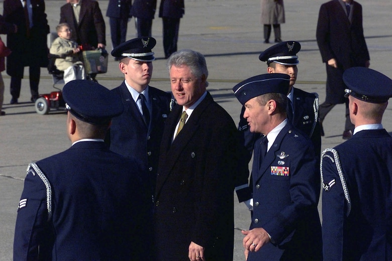 Former President of the United States, Williams Jefferson Clinton is escorted by Brig. Gen. Gregory H. Power, former 55th Wing commander at Offutt AFB, Nebraska upon his arrival on Dec. 8, 2000.