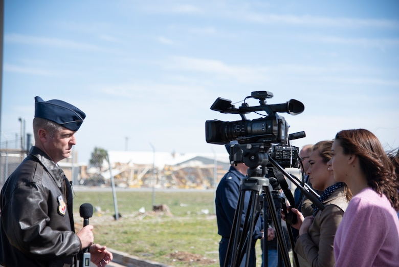 U.S. Air Force Col. Brian Laidlaw, 325th Fighter Wing commander, talks with reporters after the celebration of Bay County, Fla., being named a Great American Defense Community, at Tyndall Air Force Base, Feb. 13, 2019. Bay County, is one of five communities across the country to be named a Great American Defense Community in 2019. The GADC program leaders work to recognize military communities and regions that help improve the quality of life for veterans, service members and their families. (U.S. Air Force photo by Senior Airman Javier Alvarez)