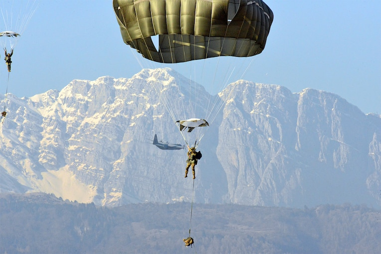 Army paratroopers descend.