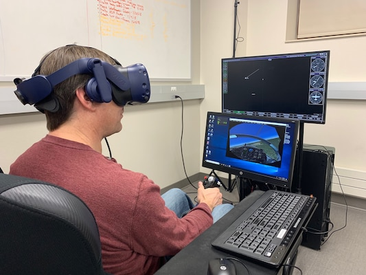 Dr. Jeff McGough, South Dakota School of Mines and Technology Computer Science and Engineering Department head, evaluates a virtual reality trainer sent from Air Education and Training Command's Pilot Training Next program. A technology team at the school has begun work on improving the trainer used in pilot training.