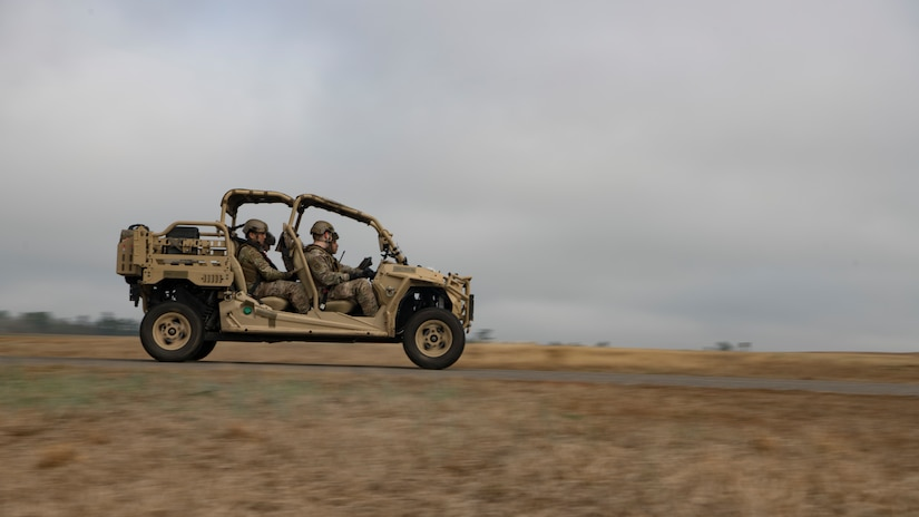 Airmen from the 621 Contingency Response Wing drive through the airfield in an all-terrain vehicle during Exercise Crescent Moon Feb. 12, 2019, at North Auxiliary Airfield in North, S.C.