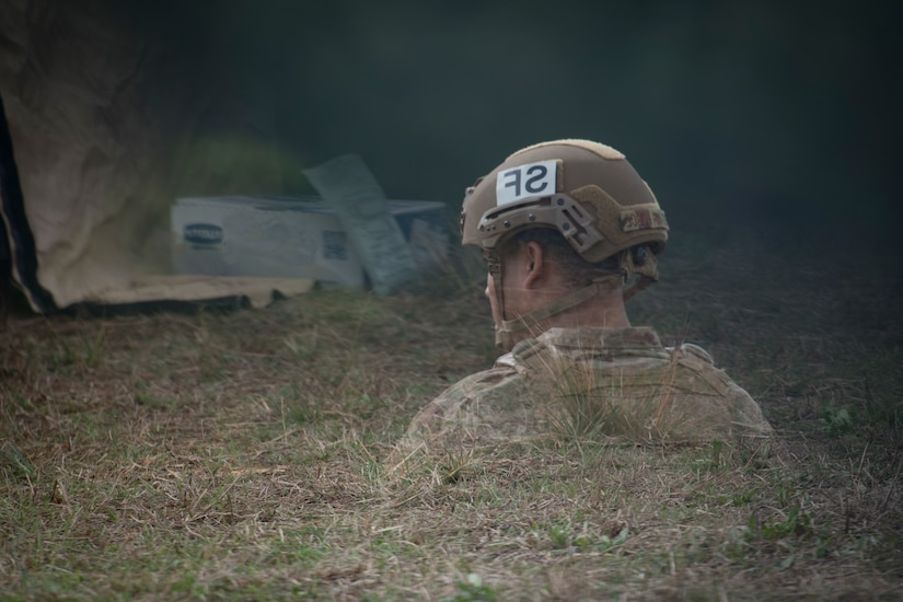 An Airman is reflected in a vehicle mirror while he heats up his MRE, (meal ready to eat), during Exercise Crescent Moon Feb. 12, 2019, at North Auxiliary Airfield in North, S.C.