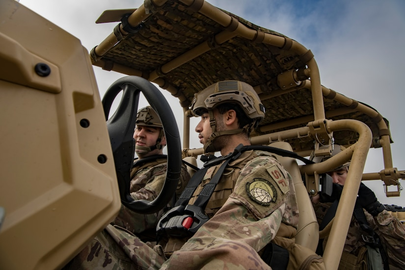 Staff Sgt. Daniel Olszewski, 621st Contingency Response Support Squadron communication operator, left, and Senior Airman Robert Bloech, 621st Contingency Response Squadron security forces member, right, prepare to drive an all-terrain vehicle during Exercise Crescent Moon Feb. 12, 2019, at North Auxiliary Airfield in North, S.C.