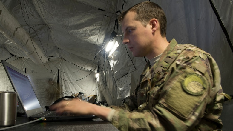Maj. Kurt Degerlund, 621st Contingency Response Squadron pilot, works on a laptop during Exercise Crescent Moon Feb. 12, 2019, at North Auxiliary Airfield in North, S.C.