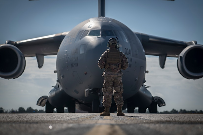 Staff Sgt. Nathaniel Ramos, 321st Contingency Response Squadron maintainer, stands guard in front of a Joint Base Charleston C-17 Globemaster III during Exercise Crescent Moon Feb. 12, 2019, at North Auxiliary Airfield in North, S.C.