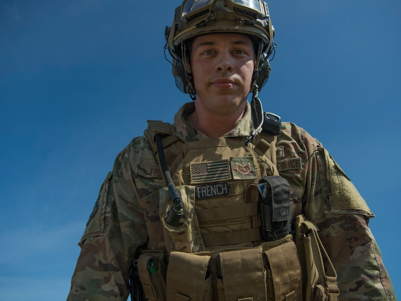 Staff Sgt. Cory French, 621st Contingency Response Squadron aerial porter, walks through the airfield during Exercise Crescent Moon Feb. 12, 2019, at North Auxiliary Airfield in North, S.C.