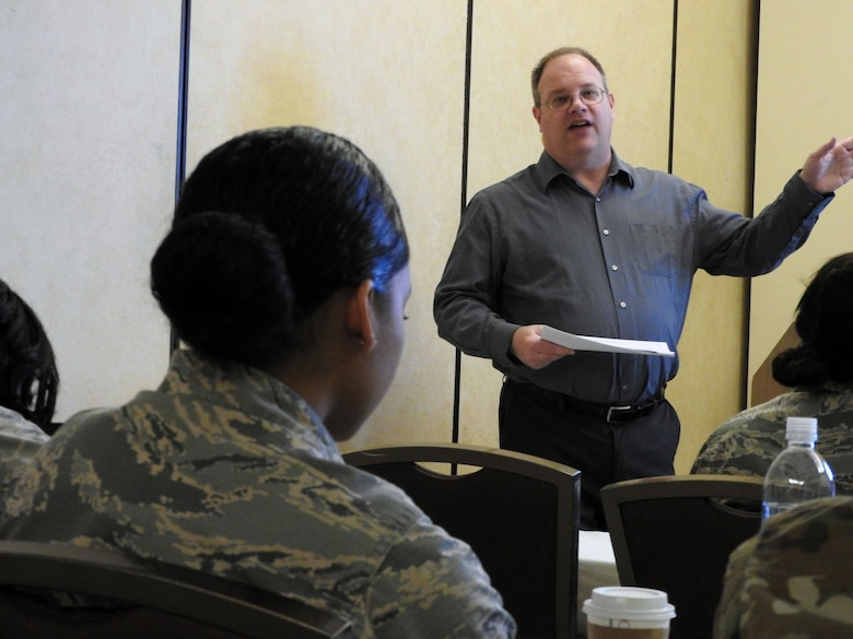 Greg Hansel, a branch chief from the Air Force Financial Services Center, shares evacuation voucher processing tips with Air Force financial services technicians during a workshop in San Antonio, Texas, Feb. 14.