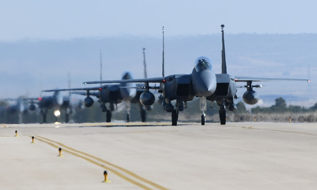 Four U.S. Air Force F-15E Strike Eagles from Royal Air Force Lakenheath, England, taxi down the flightline at Albacete Air Base, Spain, during the NATO Tactical Leadership Programme 19-1 flying course, Feb. 15, 2019. During TLP, U.S. Air Force F-15Es will conduct flying training with other NATO air forces including Spain, France, Greece, Italy, Germany, the United Kingdom and Belgium. (U.S. Air Force photo by Staff Sgt. Alex Fox Echols III)