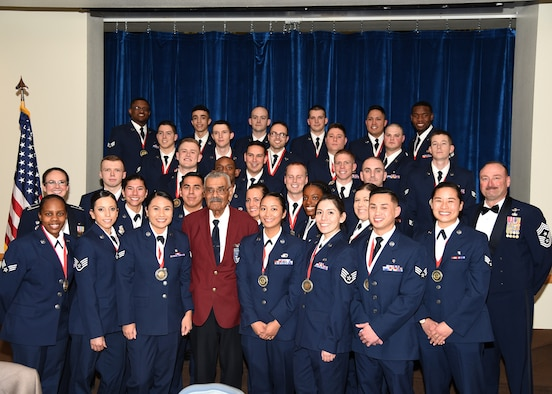 Col. Stacy Jo Huser, 90th Missile Wing commander, Chief Master Sgt. Kristian Farve, 90th Missile Wing Command Chief, and special guest speaker and Tuskegee Airman Frank Macon pose with the graduating Airman Leadership School Class 19-C students in the Trail's End Event Center on F.E. Warren Air Force Base, Wyo., Feb. 13, 2019. Enlisted Airmen must complete the rigorous professional military education course before supervising other Airmen.