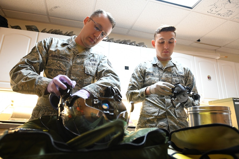 Tech. Sgt. Anthony Farnsworth (left), a reservist in the 419th Operations Support Flight, and Airman 1st Class Ryan Joplin, an active duty Airman in the 388th Operations Support Squadron, work together in the Aircrew Flight Equipment shop on flight equipment