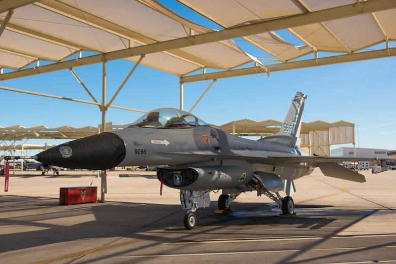 An F-16 Fighting Falcon with a completed vintage paint design sits on the runway at Luke Air Force Base, Ariz. The F-16 will promote the heritage and role the aircraft has played in the Air Force and the Airmen who fly and maintain it. (U.S. Air Force photo by Senior Airman Caleb Worpel)
