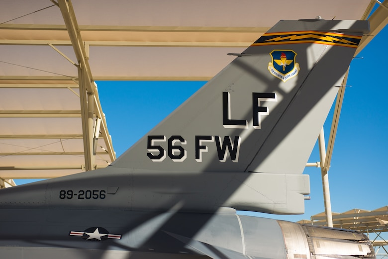 An F-16 Fighting Falcon sits on the runway with its newly painted vintage tail flash at Luke Air Force Base, Ariz. The F-16 will promote the heritage and role the aircraft has played in the Air Force and the Airmen who fly and maintain it. (U.S. Air Force photo by Senior Airman Caleb Worpel)