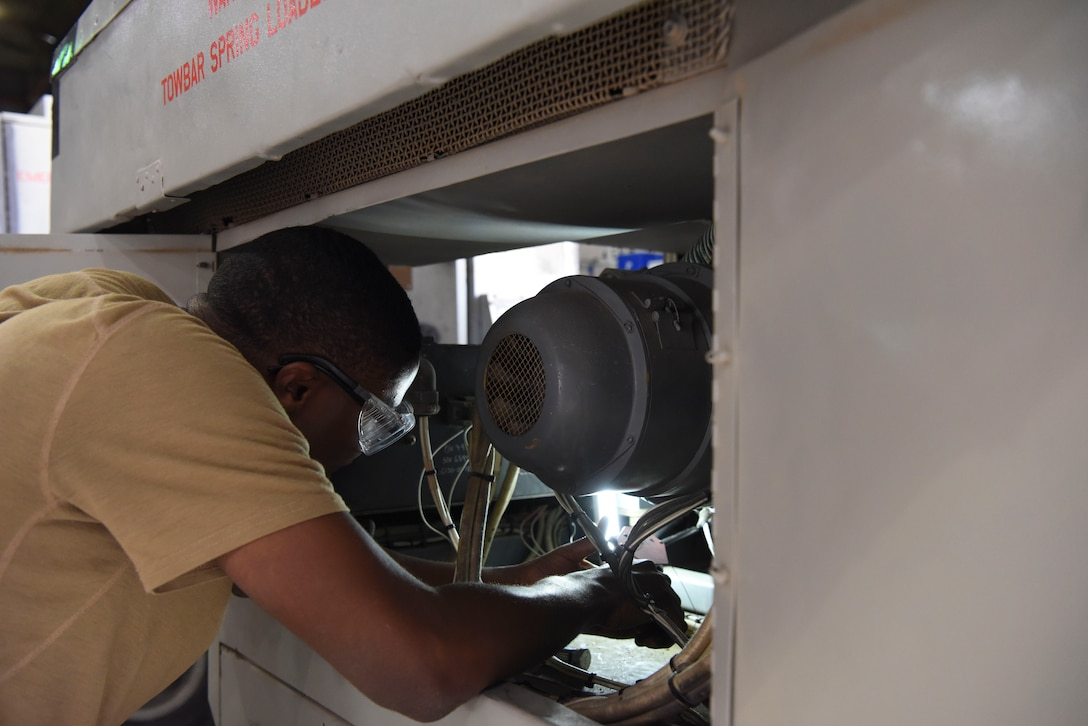Staff Sgt. Evan Rose, 380th Expeditionary Maintenance Squadron Aerospace Ground Equipment craftsman, installs a fuels control unit onto a Dash 60 generator, Feb. 11, 2019, at Al Dhafra Air Base, United Arab Emirates.