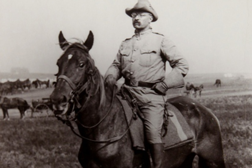 A man in uniform sits atop a horse.