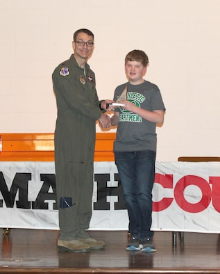 Alex Dixon, pictured right, receiving his first place individual award from AEDC Commander Col. Scott Cain, for the skills he displayed during the MathCounts® Competition held Feb. 2 at the University of Tennessee Space Institute. The MathCounts® Competition is sponsored by the Tullahoma Chapter of the Tennessee Society of Professional Engineers. (Courtesy photo)