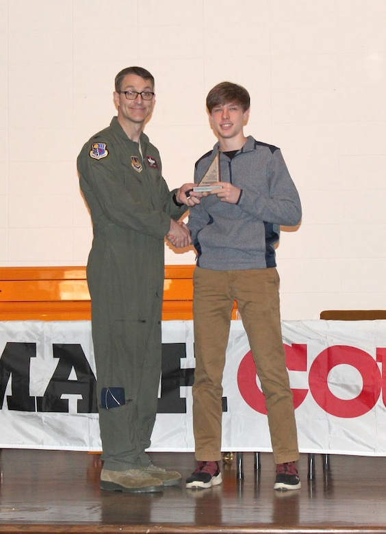 Zane Hopf, pictured right, receiving his third place individual award from the MathCounts® Regional Competition from AEDC Commander Col. Scott Cain. The MathCounts® Competition, held Feb. 2 at the University of Tennessee Space Institute, is sponsored by the Tullahoma Chapter of the Tennessee Society of Professional Engineers. (Courtesy photo)