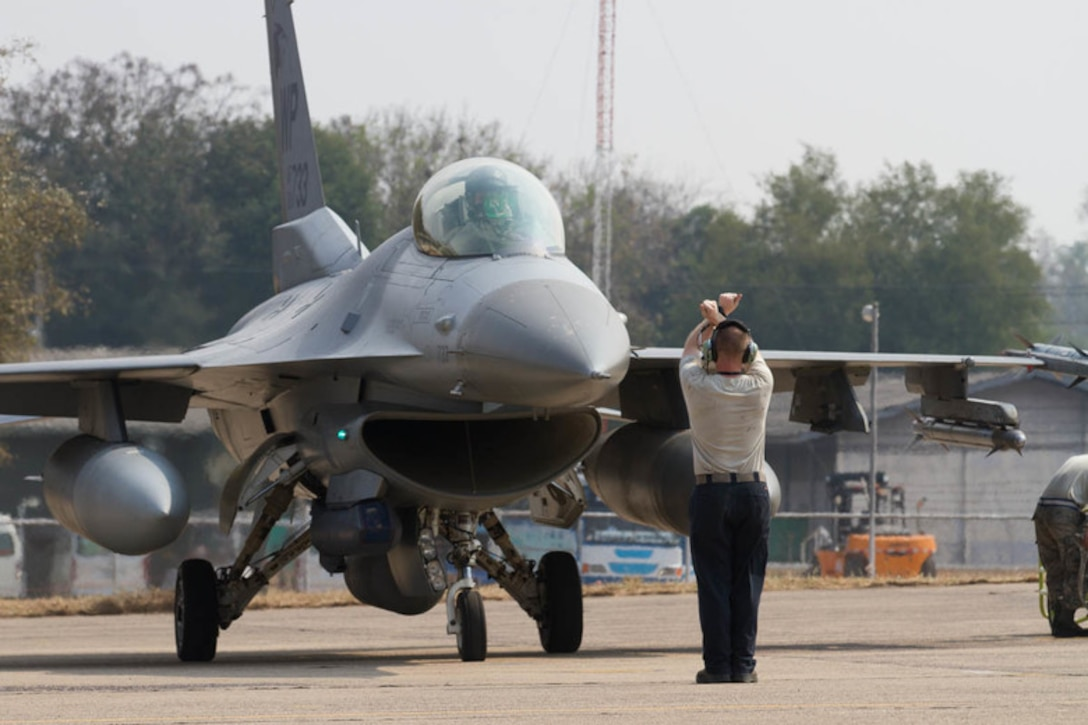 U.S. Air Force F-16 Fighting Falcon, assigned to the 35th Fighter Squadron, Republic of Korea, is marshaled in prior to Exercise Cobra Gold 2019 at Korat Royal Thai Air Force Base, Thailand, Feb. 6, 2019. Cobra Gold provides a venue for both U.S. and partner nations to advance interoperability and increase partner capacity in planning and executing complex and realistic multinational force and combined task force operations. (U.S. Army photo by Spc. Valencia McNeal)
