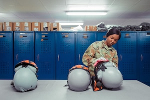 U.S. Air Force Staff Sgt. Kayla Stennis, 391st Expeditionary Fighter Squadron aircrew flight equipment craftsman, cleans a helmet visor February 14, 2019 in Southwest Asia. The AFE section ensures all the life support equipment is ready to meet the demands of the mission. (U.S. Air Force photo by Staff Sgt. Delano Scott)