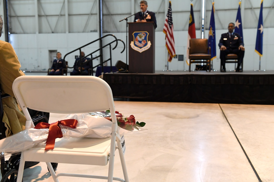 """A bouquet of red roses was placed in a chair marked """"reserved"""" along side of family members in the front row as a remembrance of U.S. Air Force Brig. Gen. Clarence Ervin's late wife during the retirement ceremony at the North Carolina Air National Guard Base (NCANG), Charlotte Douglas International Airport, Feb. 09, 2019. Family, friends and guard members gathered to celebrate the retirement of Gen. Ervin, Chief of Staff for the NCANG, after serving in the military for 37 years."""