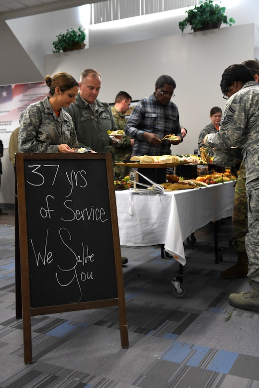 A sign displays a special salute to U.S. Air Force Brig. Gen. Clarence Ervin's 37-year military service during the retirement reception at the North Carolina Air National Guard Base (NCANG), Charlotte Douglas International Airport, Feb. 09, 2019. Family, friends and guard members gathered to celebrate the retirement of Gen. Ervin, Chief of Staff for the NCANG.