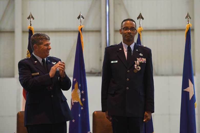 U.S. Air Force Maj. Gen., Retired, Todd Kelly applauds Brig. Gen. Clarence Ervin during his retirement ceremony at the North Carolina Air National Guard Base (NCANG), Charlotte Douglas International Airport, Feb. 09, 2019. Family, friends and guard members gathered to celebrate the retirement of Gen. Ervin, Chief of Staff for the NCANG, after serving in the military for 37 years.