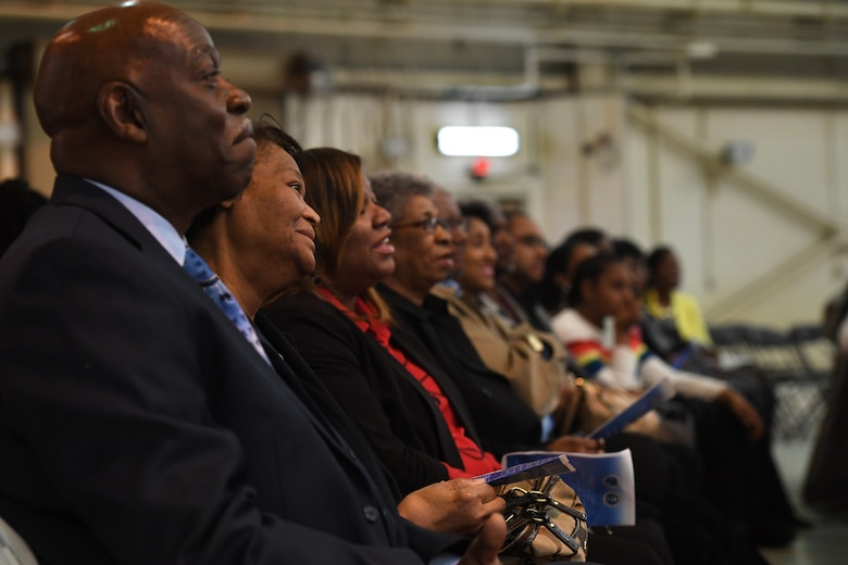 Family and friends smile and applaud during U.S. Air Force Brig. Gen. Clarence Ervin's retirement ceremony at the North Carolina Air National Guard Base (NCANG), Charlotte Douglas International Airport, Feb. 09, 2019. Family, friends and guard members gathered to celebrate the retirement of Gen. Ervin, Chief of Staff for the NCANG, after serving in the military for 37 years.