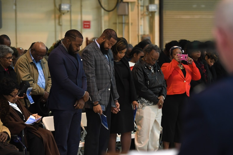 Family and friends bow their heads as U.S. Air Force Lt. Col. Jeffrey Kidd, 145th Airlift Wing Chaplain, delivers the benediction during Brig. Gen. Clarence Ervin's retirement ceremony at the North Carolina Air National Guard Base (NCANG), Charlotte Douglas International Airport, Feb. 09, 2019. Family, friends and guard members gathered to celebrate the retirement of Gen. Ervin, Chief of Staff for the NCANG, after serving in the military for 37 years.