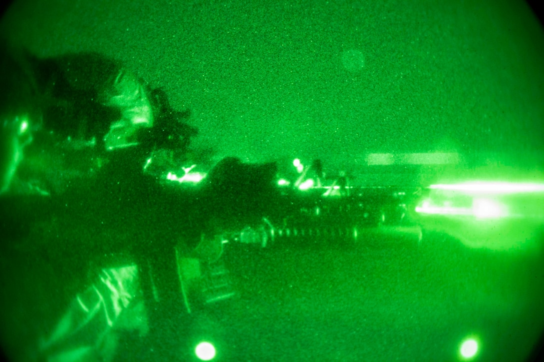 Infantry Marines, with the 22nd Marine Expeditionary Unit, fire at their targets during a night deck shoot on the Whidbey Island-class dock landing ship USS Fort McHenry. The Marines are with battalion landing team 1st Battalion, 2nd Marine Regiment and performed a night deck shoot to maintain combat readiness. Marines and Sailors with the 22nd MEU and Kearsarge Amphibious Ready Group are currently deployed to the U.S. 5th Fleet area of operations in support of naval operations to ensure maritime stability and security in the Central Region, connecting the Mediterranean and the Pacific through the western Indian Ocean and three strategic choke points.