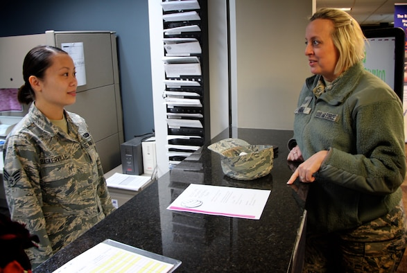 U.S. Air Force reservist and Citizen Airman, Senior Airman Kathryn Baskerville, 932nd Airlift Wing, Force Support Squadron customer support technician, listens to a question from 932nd Recruiting Squadron recruiter Tech. Sgt. Sara Seibel.  Sergeant Seibel stopped by Feb. 9, 2019, at Scott Air Force Base, Illinois, to visit the wing she has helped recruit for several years.  The front desk at the 932nd Airlift Wing headquarters building helps both wing members and active duty with identification cards and other FSS issues and questions.  For more information on joining the Air Force Reserve Command, those interested can contact Air Force Reserve recruiting at 1-800-257-1212 or (618)-781-1185.  (U.S. Air Force photo by Lt. Col. Stan Paregien)
