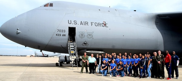 Benjamin O. Davis High School Air Force Air Force Junior Reserve Officer Training Corps students and chaperones from Aldine, Texas, and 68th Airlift Squadron air crew personnel, take a moment after a tour of a C-5M Super Galaxy Feb. 15 at Joint Base San Antonio-Lackland.